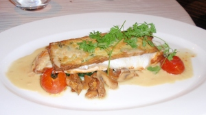 Sea bass fillet, fresh salmon stuffing, with savory puff pastry, seasonal vegetables & a tangy sauce