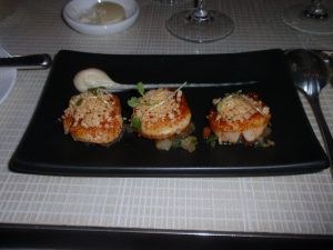 Sautéed sea scallops with chorizo, orange and white onion compote