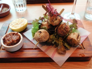 """ 'Spiedini' Sicilian pork skewer: free-range British pork fillet stuffed with Italian cured meats, breadcrumbs & parmesan – served with lemon, garlic & oregano dressing"" (£11.95)"
