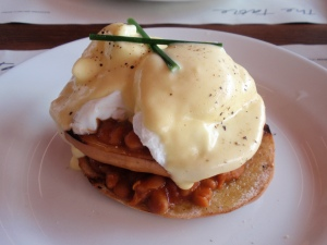 The Table's breakfast stack: home-made baked beans, red pepper pesto, chorizo sausage, two poached eggs with hollandaise, served on a fresh toasted organic bagel
