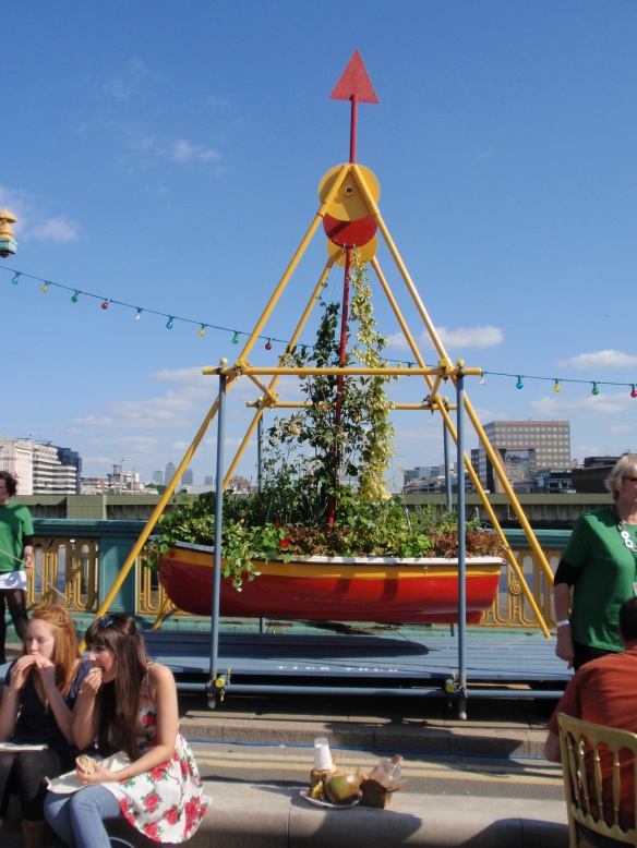 A professional artist apparently created this swinging plant boat for the festival...it was certainly colorful & interesting