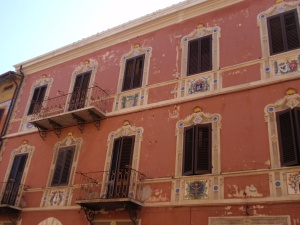 ceramics on the facades of old buildings in deruta's old town